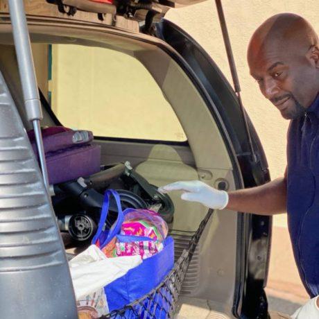 Man putting bag in trunk