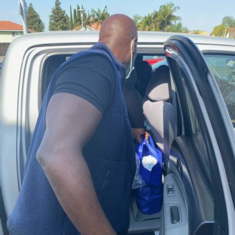 Man putting bag in car