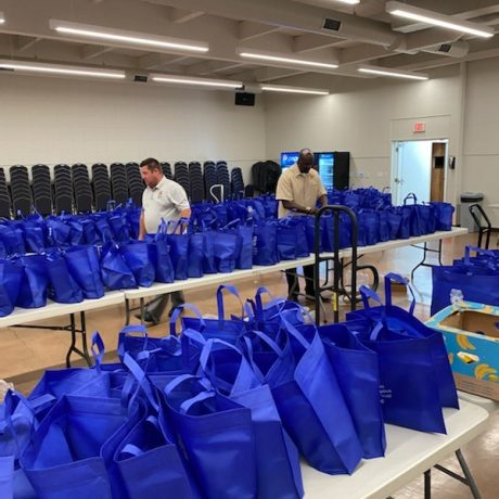 Tables with blue bags on them