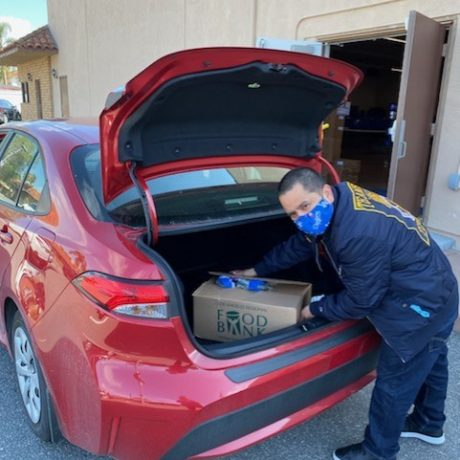 Man getting box out of trunk
