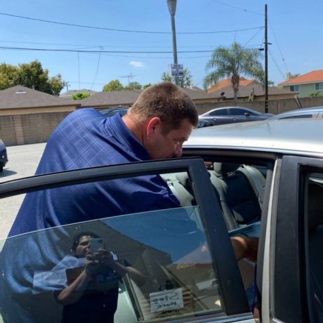Man next to open car door